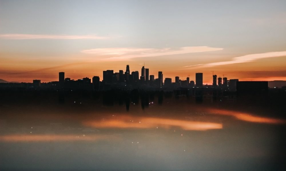 the setting sun and heat create a blur effect in this cityscape shot of Los Angeles